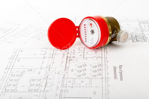 Red water meter on draft Stock photo © cherezoff