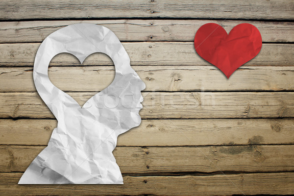 Paper humans head with heart Stock photo © cherezoff