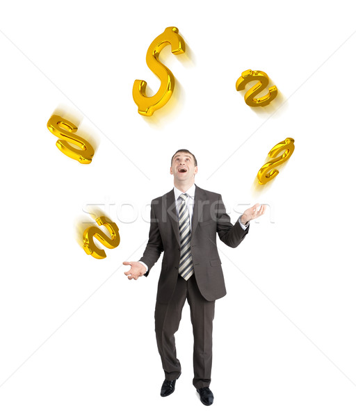 Businessman juggling dollar signs Stock photo © cherezoff