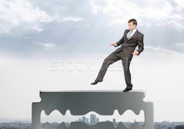 бизнесмен ходьбе осторожно старые бритва лезвия Сток-фото © cherezoff