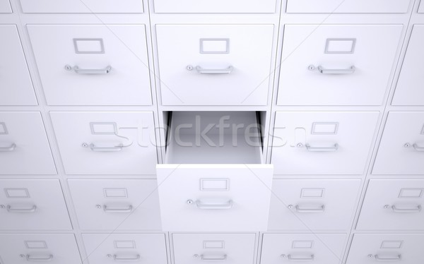 Office bookcase with drawers. One box is open Stock photo © cherezoff
