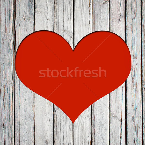 Heart carved on a wooden surface Stock photo © cherezoff