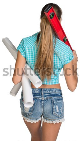 Beautiful girl in white helmet, shorts and shirt holding builder's level on the shoulder. Rear view Stock photo © cherezoff