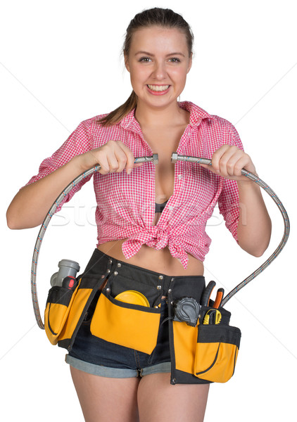 Woman in tool belt holding flexible tap hose Stock photo © cherezoff