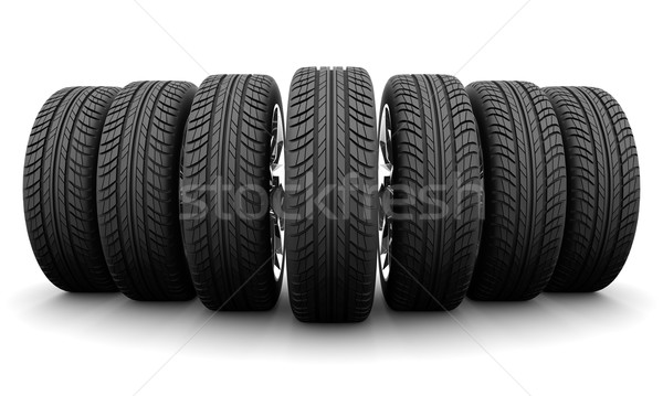 Wedge of seven car wheels. Isolated on white background Stock photo © cherezoff