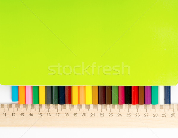 Crayons with ruler and copybook, close up view Stock photo © cherezoff