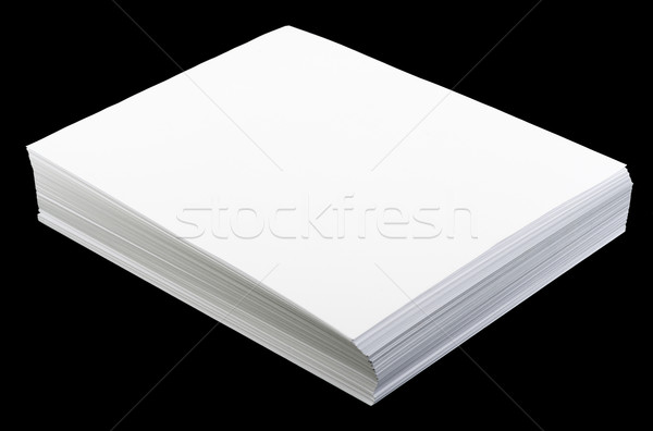 Blank sheets of paper on black background Stock photo © cherezoff