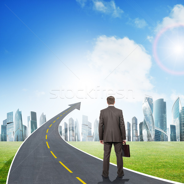 Businessman standing on roadway going up as arrow Stock photo © cherezoff