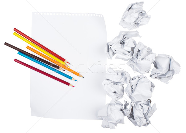 Paper with crayons and crumpled paper balls Stock photo © cherezoff