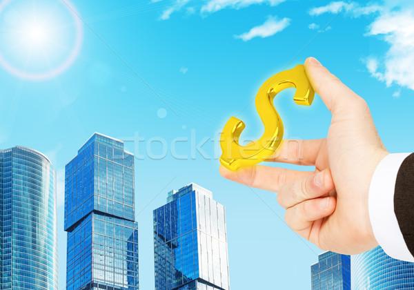 üzletember kéz dollárjel város pénz kék Stock fotó © cherezoff