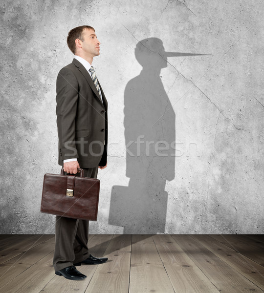 Businessman with long nose Stock photo © cherezoff