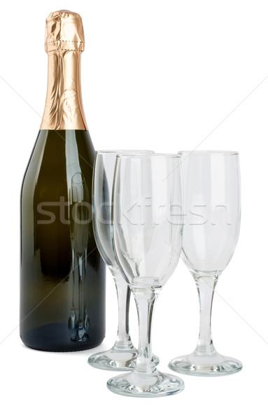 Champagne bottle and three glasses  Stock photo © cherezoff
