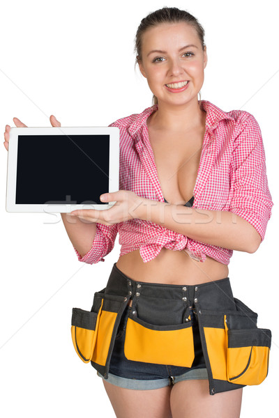 Woman in tool belt showing tablet PC with blank screen Stock photo © cherezoff