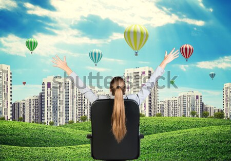 Woman sitting in chair, leaned back and put hands behind her head Stock photo © cherezoff