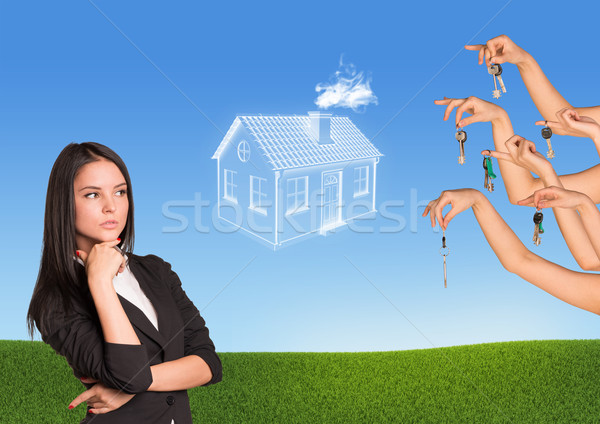 Businesswoman with brooding eyes Stock photo © cherezoff