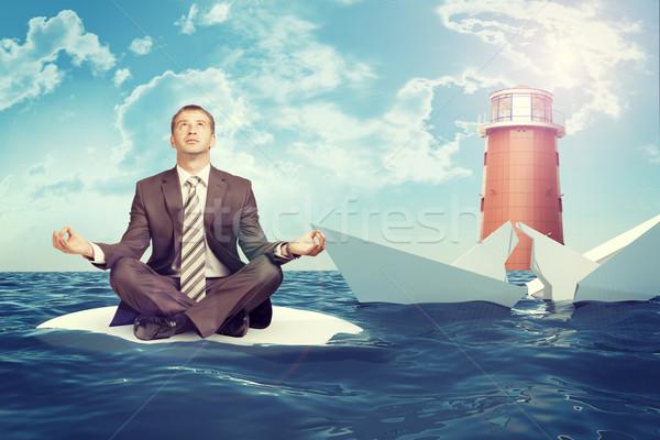 üzletember süllyed törött hajó ül lótusz Stock fotó © cherezoff