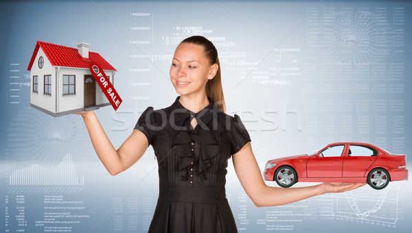 Businesslady holding car and house Stock photo © cherezoff
