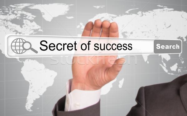 Kéz tart böngésző szavak titok siker Stock fotó © cherezoff