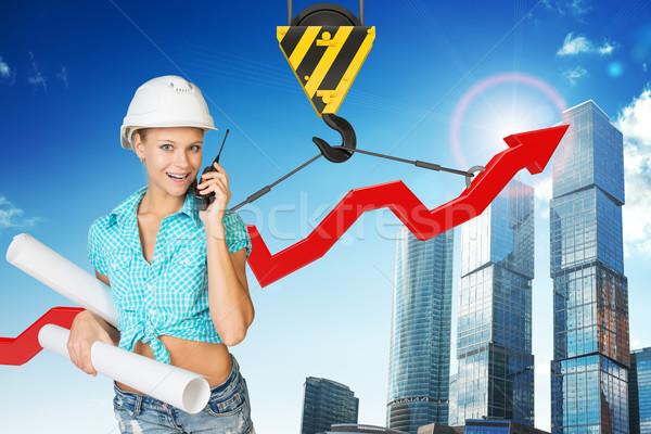 Businesslady with walkie-talkie set Stock photo © cherezoff