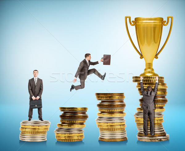 Set of businessman trying to get gold cup Stock photo © cherezoff