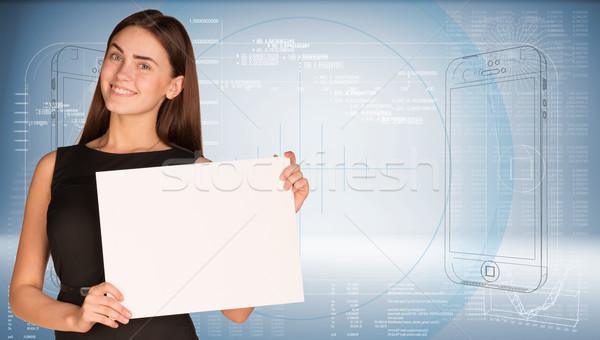 Femme d'affaires papier fiche graphiques main Photo stock © cherezoff