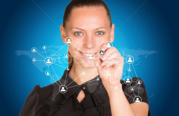 Beautiful businesswoman in dress presses virtual network Stock photo © cherezoff