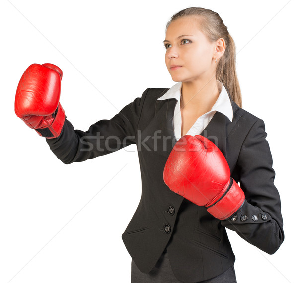 Businesswoman wearing boxing gloves, her lips parted Stock photo © cherezoff