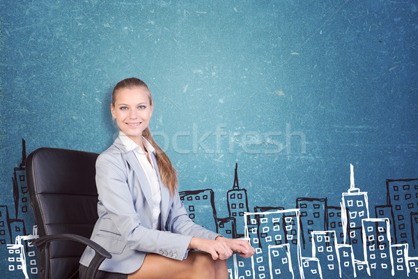 Businesswoman sitting with clipboard on her knees Stock photo © cherezoff