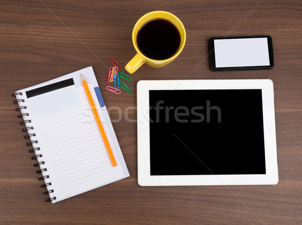Blank copybook with tablet and coffee Stock photo © cherezoff