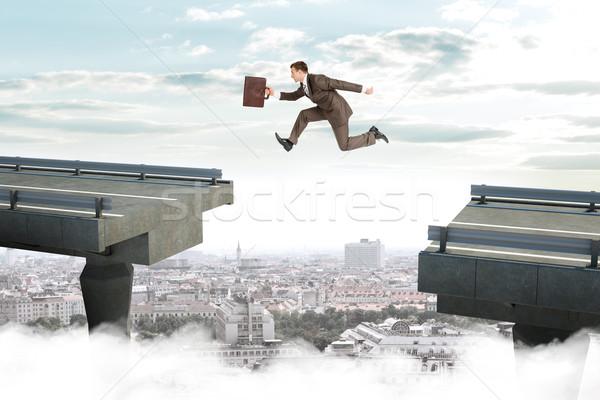 Görüntü genç işadamı atlama boşluk bavul Stok fotoğraf © cherezoff