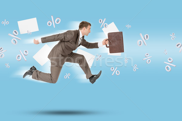 Businessman running forward Stock photo © cherezoff