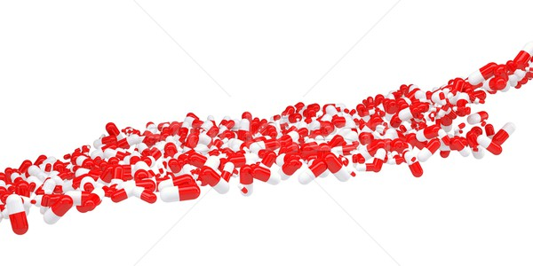 The flow of red and white pills Stock photo © cherezoff
