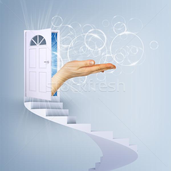 Spiral stairs and magic doors with hand Stock photo © cherezoff
