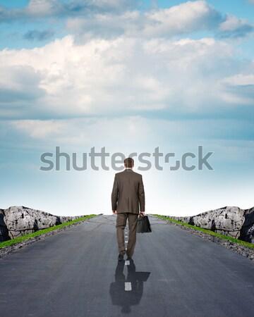 Businessman goes to stairs Stock photo © cherezoff