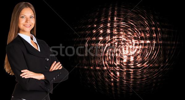 Businesswoman with background of digital code Stock photo © cherezoff