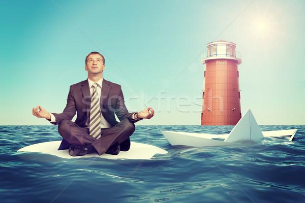 üzletember süllyed hajó ül lótusz pozició Stock fotó © cherezoff