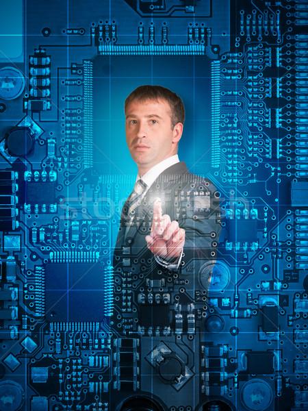 üzletember kisajtolás holografikus képernyő néz kamera Stock fotó © cherezoff