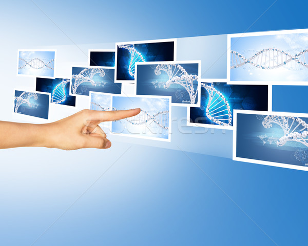 Kéz megérint kék holografikus képek absztrakt Stock fotó © cherezoff