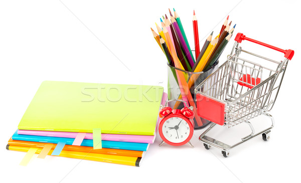 Crayons and alarm clock with shopping cart Stock photo © cherezoff