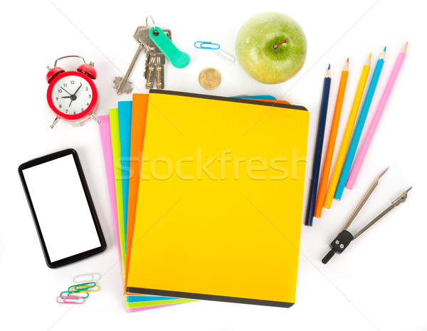 Copybooks with smartphone and office stuff Stock photo © cherezoff