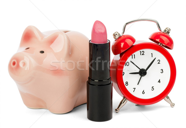 Lipstick with piggy bank and alarm clock Stock photo © cherezoff