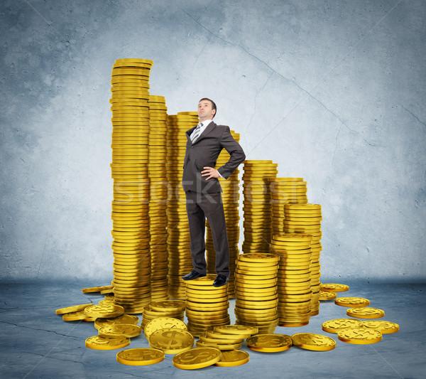 誇りに思う ビジネスマン 立って スタック コイン グレー ストックフォト © cherezoff