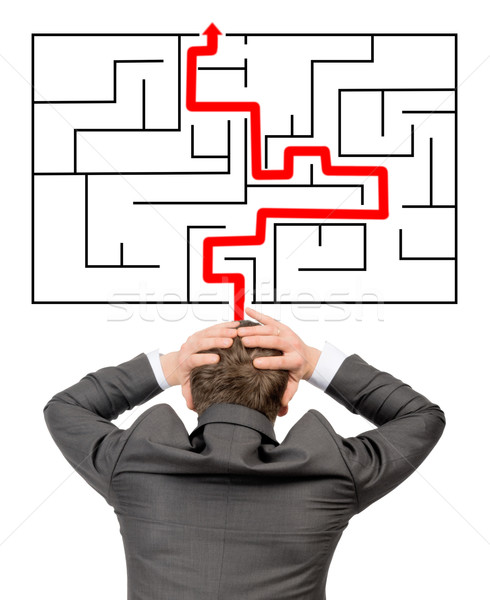 Confused businessman in front of labyrinth  Stock photo © cherezoff