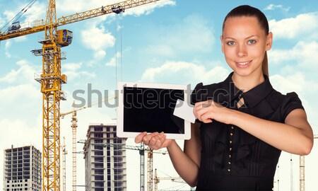 Businesswoman hold paper holder Stock photo © cherezoff