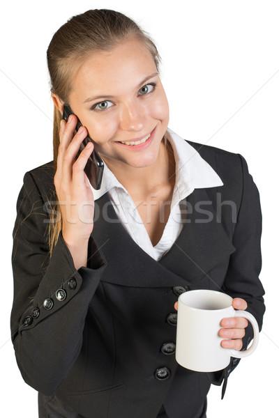 деловая женщина кружка говорить телефон глядя Сток-фото © cherezoff