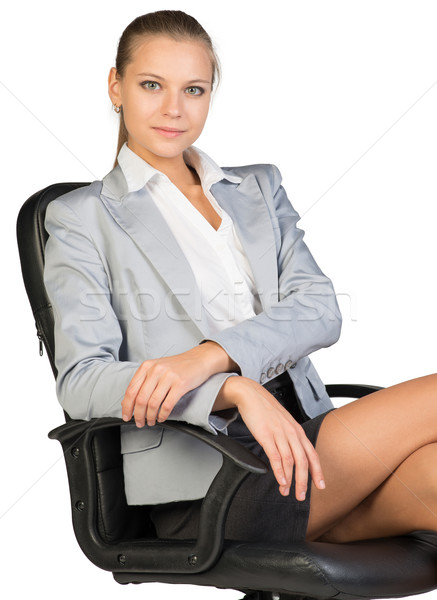 Businesswoman on office chair, looking at camera Stock photo © cherezoff