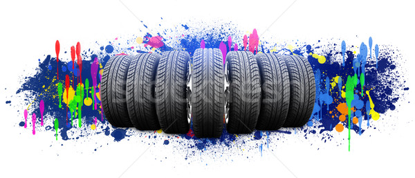 Seven new car wheels. Abstract background is colored blots Stock photo © cherezoff