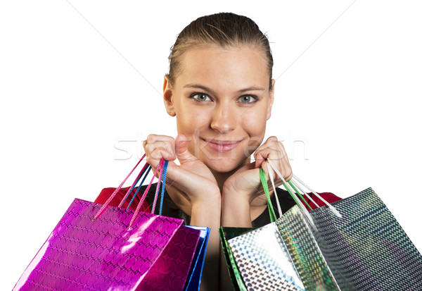 Woman with smile handing bags. Closed up Stock photo © cherezoff