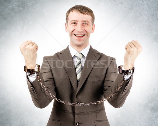 Happy businessman in cuffs  Stock photo © cherezoff