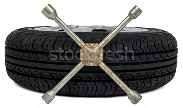 Car tyre with screwdriver Stock photo © cherezoff